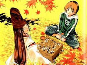 Image de Sai et Hikaru devant une table de jeu de Go avec une partie en cours